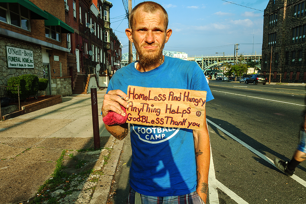 Man begging across the street from Visitation Church on 7-28-15--Kensington