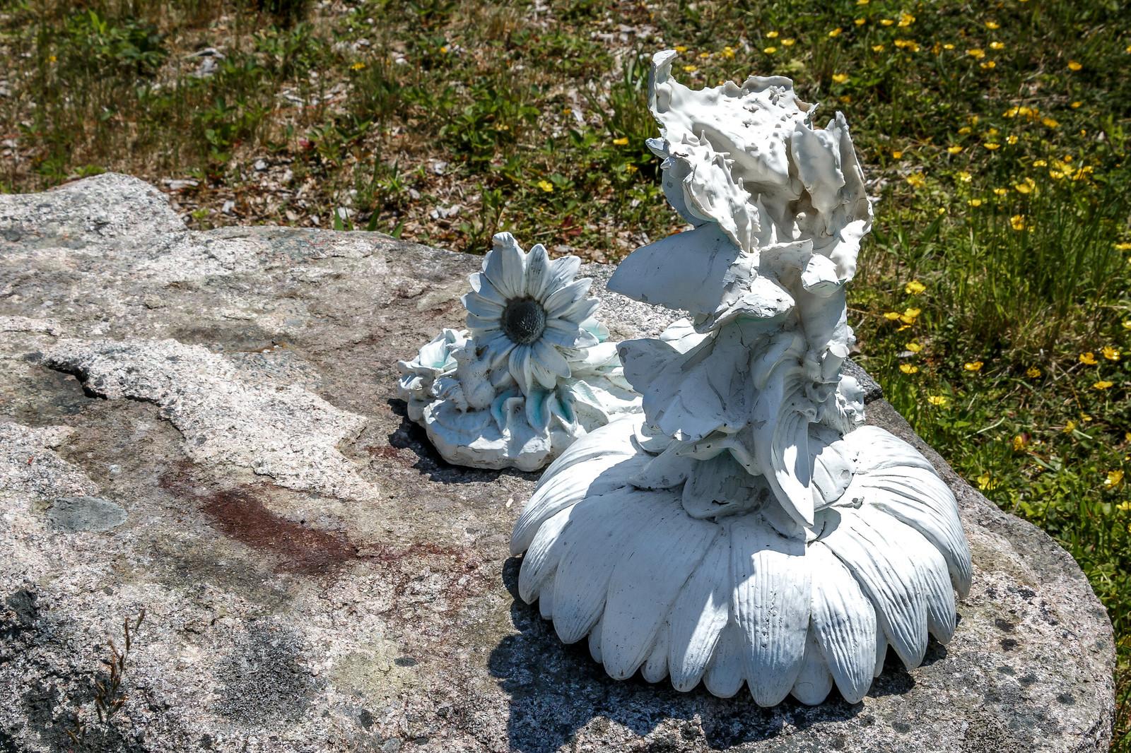 broken statue on a rock