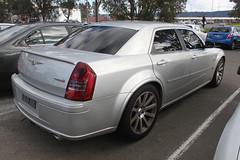 cadillac sts-v(0.0), cadillac sts(0.0), automobile(1.0), automotive exterior(1.0), wheel(1.0), vehicle(1.0), chrysler 300(1.0), chrysler(1.0), bumper(1.0), sedan(1.0), land vehicle(1.0), luxury vehicle(1.0),