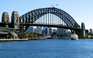 Sep 2004 - View north from Circular Quay across the harbour to the historic & iconic Sydney Harbour Bridge, with Luna Park in the background, Sydney, New South Wales, Australia