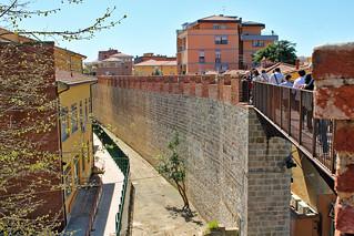 City walls of Pisa with the bridge on Via San Francesco