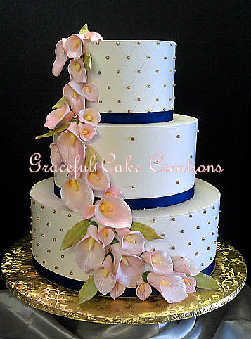 Elegant Ivory Butter Cream Wedding Cake with Gold Sugar Pearls, Navy Blue Ribbon and Blush Pink Calla Lilies