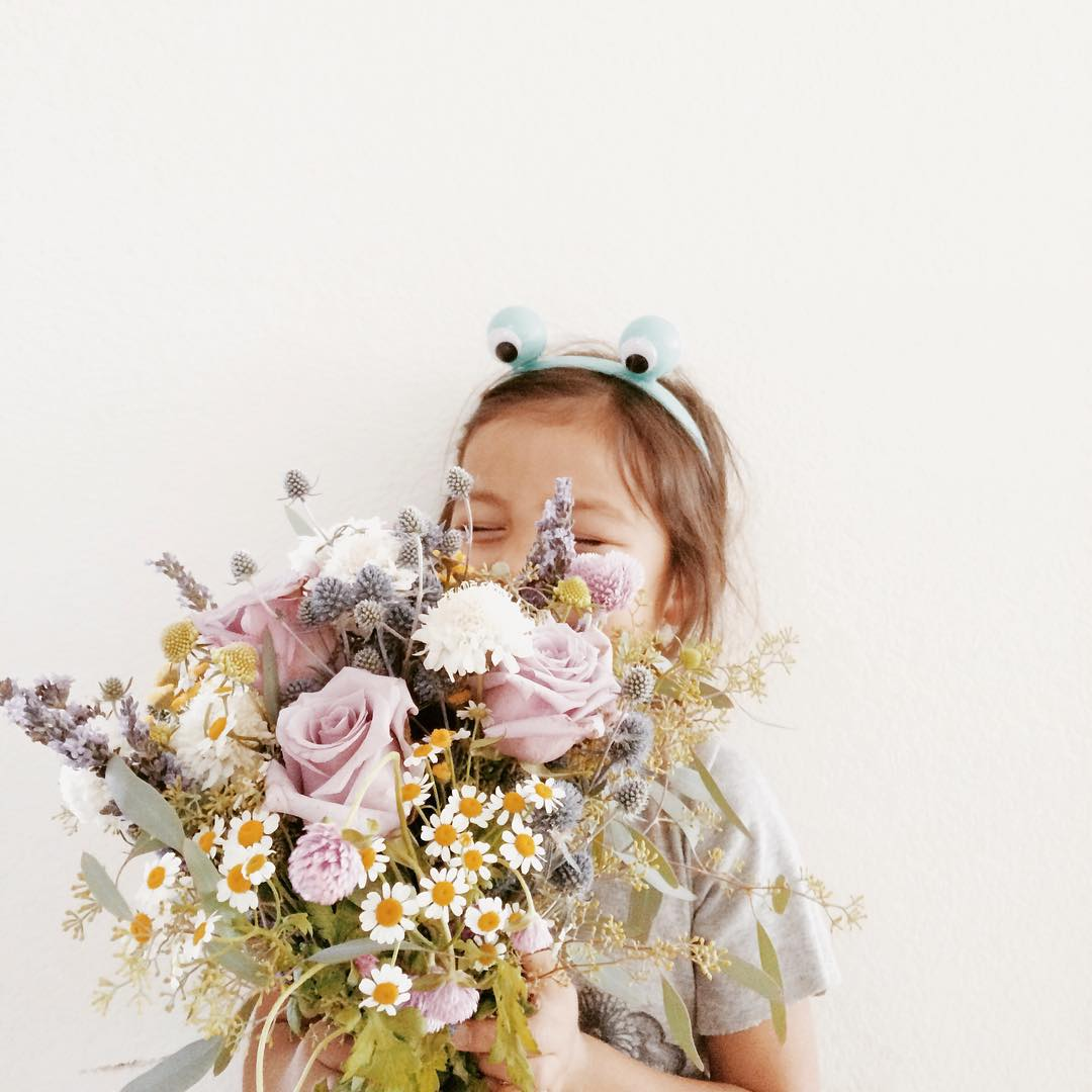She's all up in the bouquet breathing deep. That's what happens when lavender is involved. #playingflorist #yeswayj0se