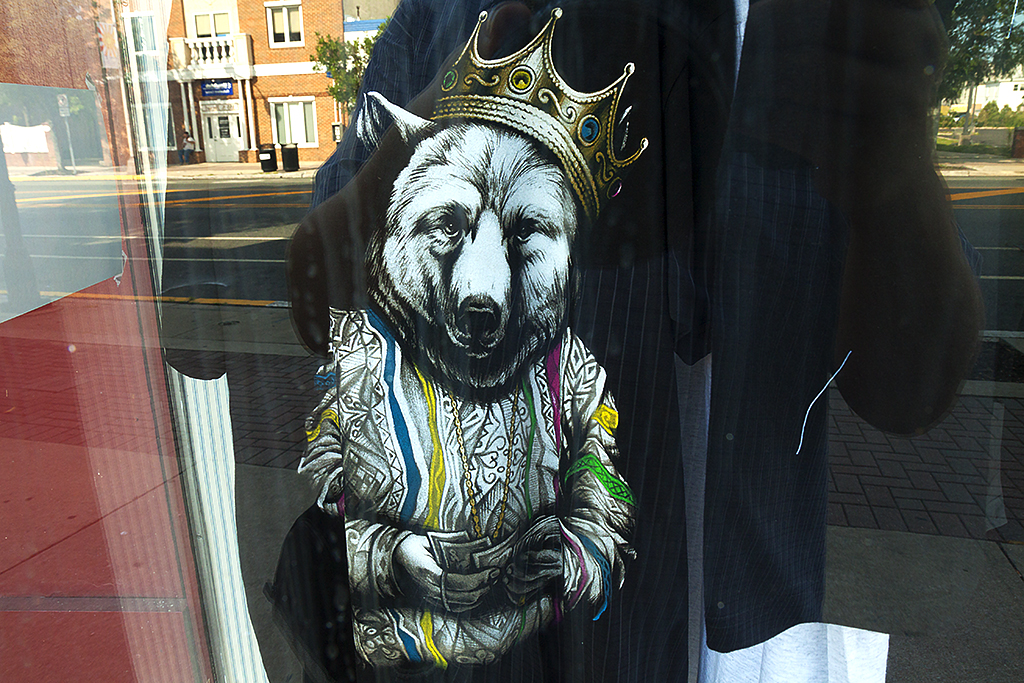 Crowned wolf counting money--Woodbury