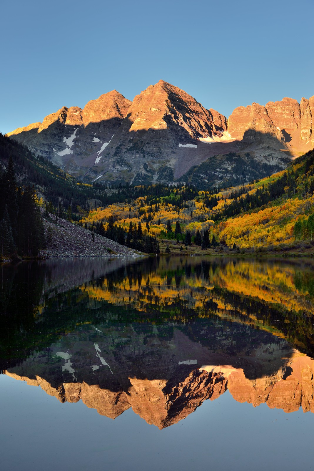 Glasslike Reflections of Maroon Bells on a Lake