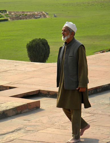 Muslim man out walking in the gardens of the Baby Taj in Agra, India