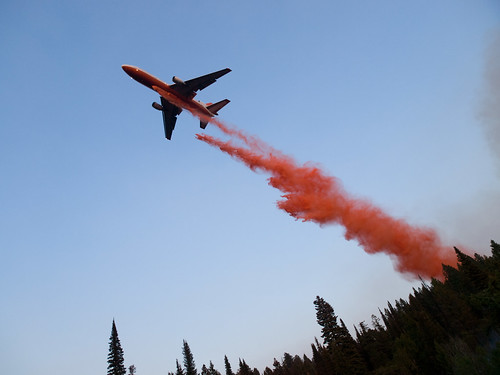 An Airtanker dropping fire retardant on a wildfire