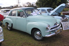1941 ford(0.0), plymouth deluxe(0.0), compact car(0.0), automobile(1.0), automotive exterior(1.0), vehicle(1.0), mid-size car(1.0), plymouth cranbrook(1.0), antique car(1.0), sedan(1.0), classic car(1.0), vintage car(1.0), land vehicle(1.0),