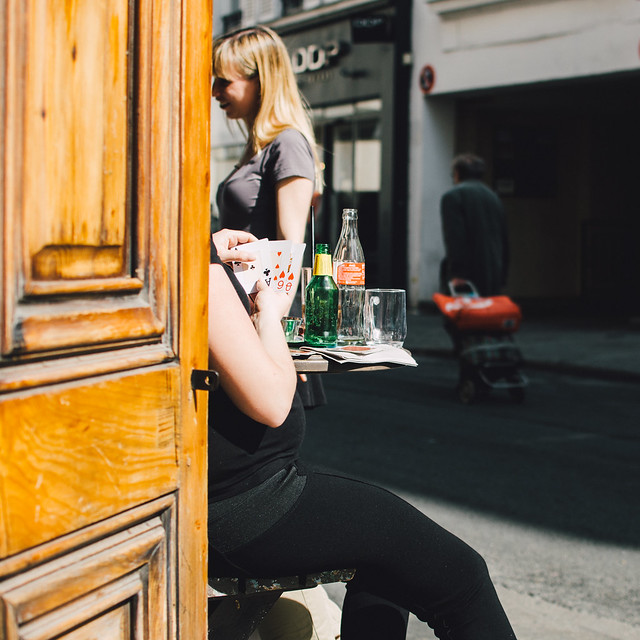 Afternoon drinks and games on the streets of Paris.