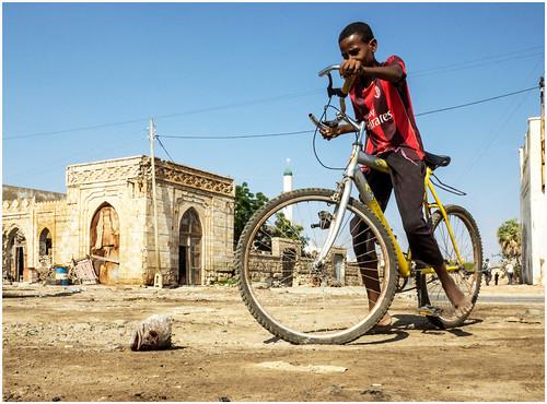 africa boy moorish ethiopia dereliction massawa eritrea hornofafrica wardamage bycylce