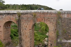 ruins(0.0), waterway(0.0), devil's bridge(1.0), arch(1.0), aqueduct(1.0), arch bridge(1.0), viaduct(1.0), bridge(1.0),