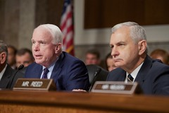 U.S. Senator John McCain, chairman of the Senate Armed Services Committee, sits with U.S. Senator Jack Reed, the panel's Ranking Member, on July 29, 2015, before they heard testimony from U.S. Secretary of State John Kerry, U.S. Defense Secretary Ash Carter, Joint Chiefs of Staff Committee Chairman Martin Dempsey, U.S. Treasury Secretary Jack Lew, and U.S. Energy Secretary Dr. Ernest Moniz in Washington, D.C. [State Department photo/ Public Domain]