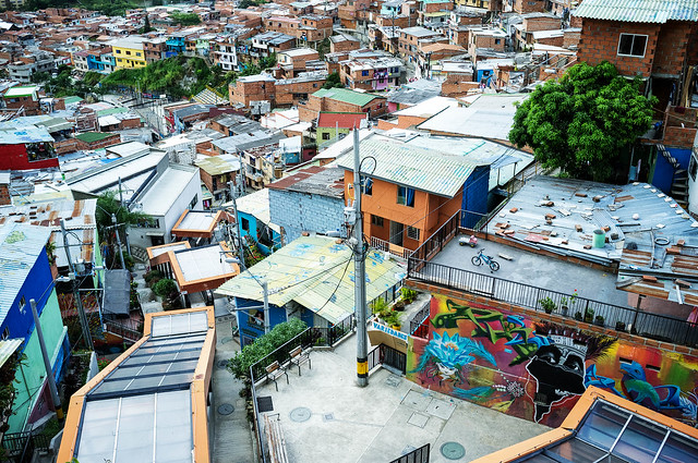 Covered escalators and houses built up a hillside in Medellin