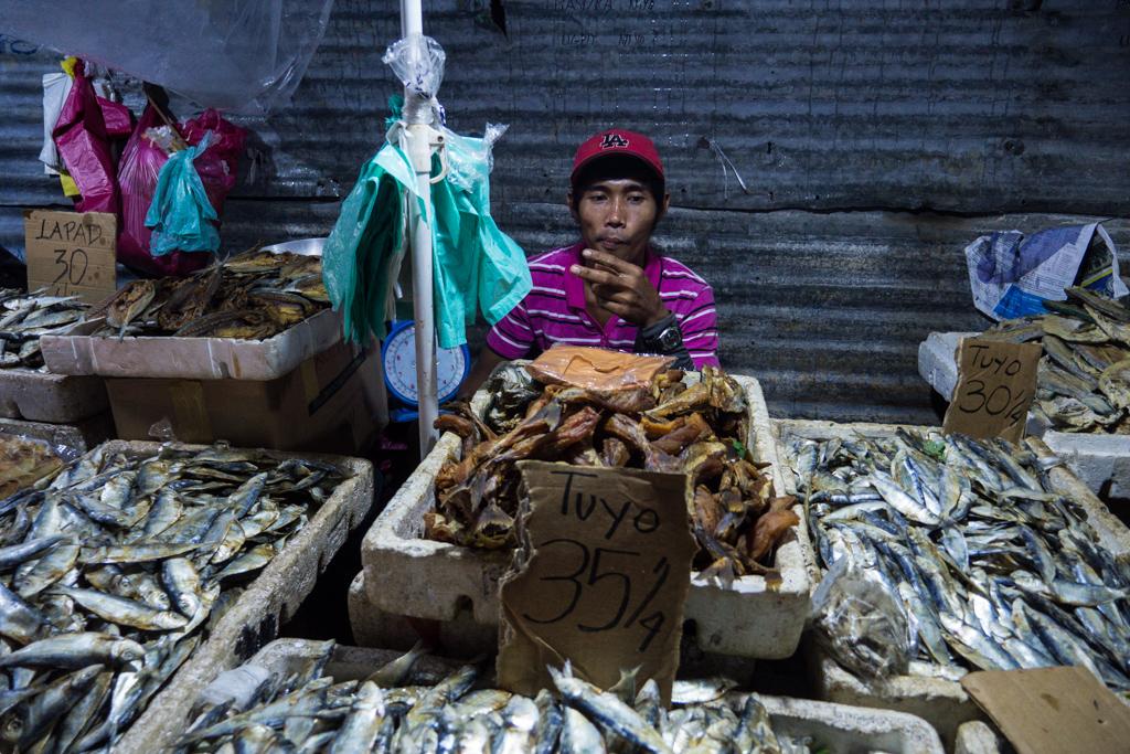 Fish seller at the markets in Puerto Princesa, Palawan, Philippines