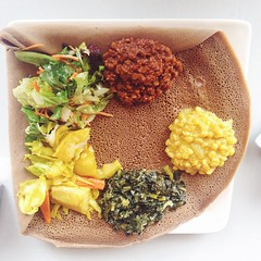Veggie Combo at Asmara. The color greens and yellow lentils were fine, but the Alicha (potato, cabbage and carrots) was compleat key bland and the Timtimo Alicha (red lentils) was painful over spiced. The injera (teff flatbread) is spongy, sour and moist