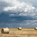 Scattered showers and bales by VFR Photography