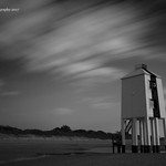 22. Jaanuar 2017 - 15:30 - After trudging down the sand dunes, me and my partner came across this lighthouse, which was keeping an eye on Wales over the horizon and beyond the sea.  Sat on wooden stilts, the sun that was forcing itself through the haze was shining perfectly to create this infrared effect. With the lighthouse that has stood firmly on this beach for years..I love how the clouds give the effect that the world is just passing it by, using my lee superstopper filter.