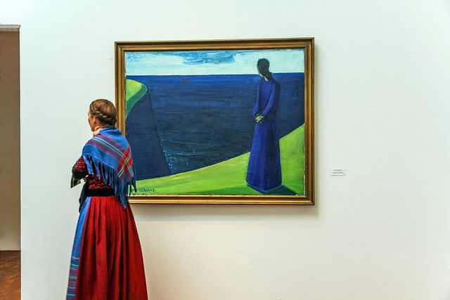 Woman and a painting by Samuel Joensen Mikines in The Faroe Islands Art Museum at Ólavsøka / Ólafsvaka in Tórshavn, Faroe Islands