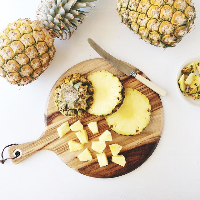 The other day I learned that the small gold pineapples (the ones with the crowns removed before selling) are actually a newish variety that is super sweet/low acid in winter. The larger ones with crowns are a summer variety.  Today I ate pineapple while s