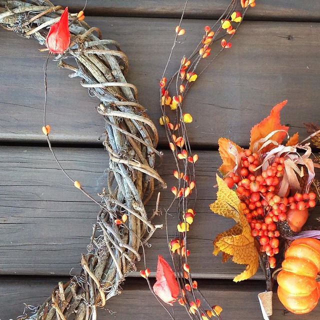 Homemade vine wreath + Craft store autumn floral decorations =