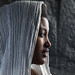 Pilgrim woman with a white shawl on her head during Timkat festival, Amhara region, Lalibela, Ethiopia by Eric Lafforgue