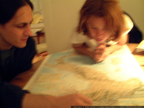 sean and xian poring over a map of italy     dscf1437