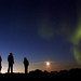 Three friends watch Northern Lights, Greenland