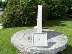 water feature(0.0), sculpture(0.0), measuring instrument(0.0), headstone(0.0), monument(0.0), grave(0.0), stele(1.0), memorial(1.0), lawn(1.0),