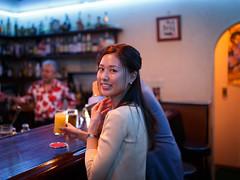 Sweet couple having lovely time in bar