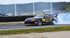 auto racing(1.0), automobile(1.0), racing(1.0), wheel(1.0), vehicle(1.0), stock car racing(1.0), sports(1.0), performance car(1.0), automotive design(1.0), drifting(1.0), motorsport(1.0), rallycross(1.0), autocross(1.0), race track(1.0), land vehicle(1.0),