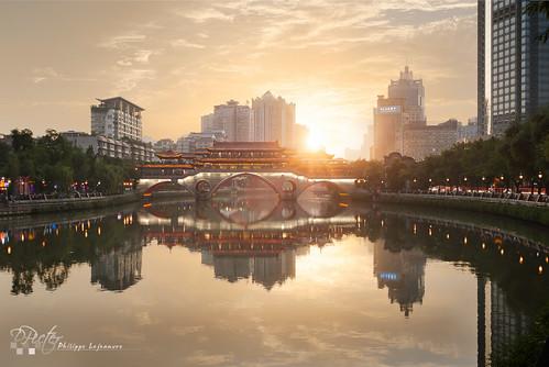 china city sunset sky sun horizontal architecture clouds buildings river outdoors photography illuminated development connexion chineseculture chengdushi sichuansheng anshunbridge