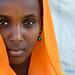 Portrait of an Oromo woman in orange veil, Amhara region, Senbete, Ethiopia by Eric Lafforgue