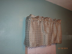 window treatment(0.0), art(1.0), pattern(1.0), textile(1.0), brown(1.0), curtain(1.0), window covering(1.0), interior design(1.0), window valance(1.0),
