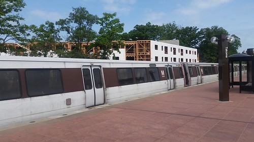 WMATA Metrorail at Takoma Station, with apartment building being constructed northwest of the station