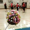 Eating a cake pop at a roller derby. Dangerously hipsterish.