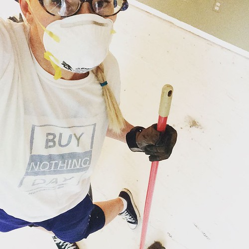 """Home renovation weekend: pulling up carpet smelling of cat piss from the previous owners and replacing it with laminate. I feel very """"grown up"""" 🏡"""