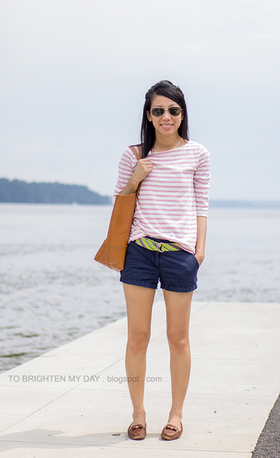 pink striped top, bright green and navy striped tie belt, navy shorts, brown loafers