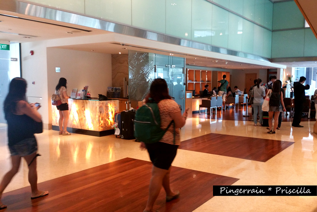 Lobby of M Hotel - Guests queuing up to check-in