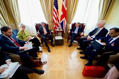 U.S. Secretary of State John Kerry sits with British Foreign Secretary Philip Hammond and their respective advisers on July 2, 2015, in Vienna, Austria, before a bilateral meeting amid the P5+1 negotiations with Iranian officials about the future of their nuclear program. [State Department photo/ Public Domain]