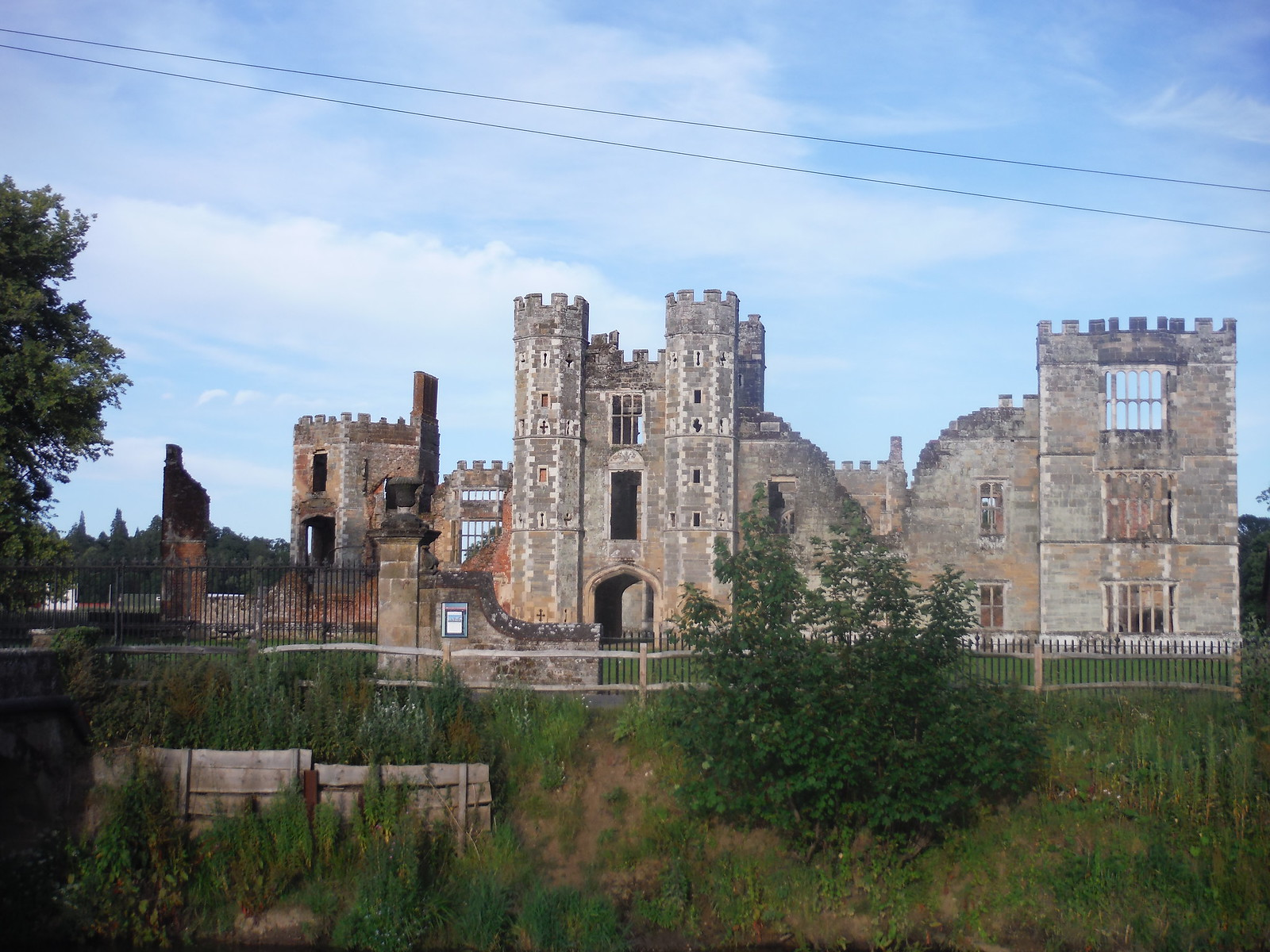 Cowdray Castle from across The Rother SWC Walk 217 Midhurst Way: Arundel to Midhurst
