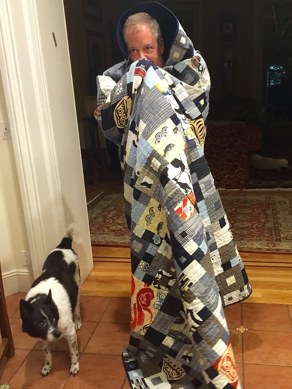My new quilt arrived from my amazing aunts in California! This picture doesn't come close to doing it justice. This is me doing a Darth Quilt imitation with little Salacious B Gogo at my side.