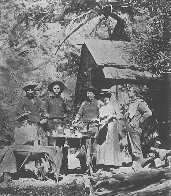 The Giddings cabin, built in 1897, Pictured (left to right) are Annie Follows, John Drips, Charlie Bauder, George Trogden, Miss Beckwith and Frank Spence