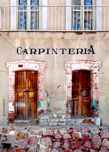 Old wall with wooden doors in Zacatecas, Mexico