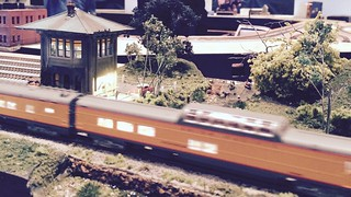 A passenger train rushes by Brook Side (BS) Tower. This T-TRAK module was built by Jim Kalenowski.