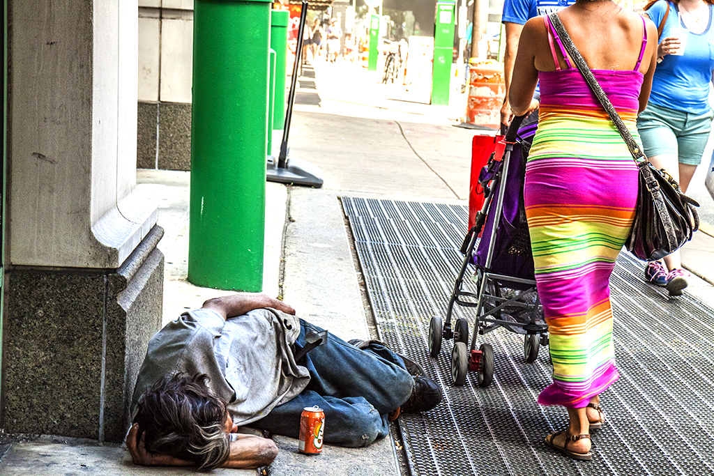 Man on ground and woman with colorful dress--Center City