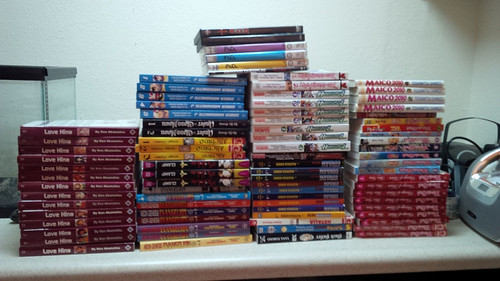 A stack of manga and DVDs