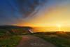 sunset with dramatic sky near Azkorri beach