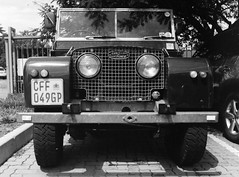 land rover defender(0.0), automobile(1.0), automotive exterior(1.0), sport utility vehicle(1.0), vehicle(1.0), off-roading(1.0), monochrome photography(1.0), off-road vehicle(1.0), land rover series(1.0), bumper(1.0), land vehicle(1.0), monochrome(1.0), black-and-white(1.0), motor vehicle(1.0),