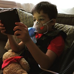 Him and his Pooh Bear - battling the sickness together. #myboy #myhero #asthmasucks