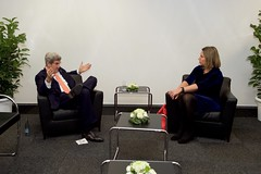 U.S. Secretary of State John Kerry speaks with European Union High Representative for Foreign Affairs Federica Mogherini on December 8, 2016, as they attend a meeting of the Organization for Security and Co-operation in Europe hosted by German Foreign Minister Frank-Walter Steinmeier, and held at the Hamburg Messe in Hamburg, Germany. [State Department Photo/ Public Domain]